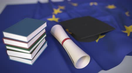 mortarboard : Graduation cap, books and diploma on the EU. Higher education in Europe related conceptual 3D animation