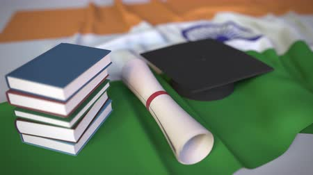 mortarboard : Graduation cap, books and diploma on the Indian flag. Higher education in India related conceptual 3D animation