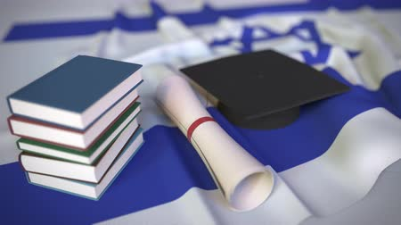 diploma : Graduation cap, books and diploma on the Israeli flag. Higher education in Israel related conceptual 3D animation