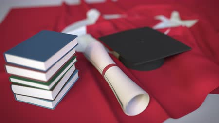 mortarboard : Graduation cap, books and diploma on the Turkish flag. Higher education in Turkey related conceptual 3D animation Stock Footage