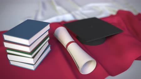 diploma : Graduation cap, books and diploma on the Polish flag. Higher education in Poland related conceptual 3D animation