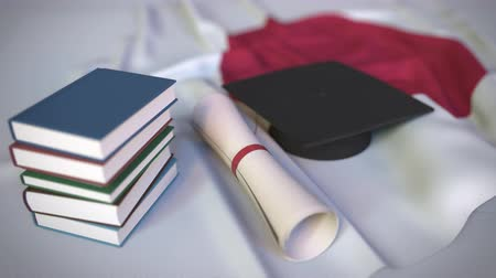mortarboard : Graduation cap, books and diploma on the Japanese flag. Higher education in Japan related conceptual 3D animation