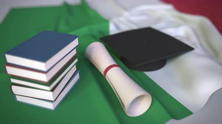 диплом : Graduation cap, books and diploma on the Italian flag. Higher education in Italy related conceptual 3D animation