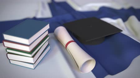 aluno : Graduation cap, books and diploma on the Finnish flag. Higher education in Finland related conceptual 3D animation