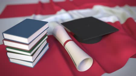 diploma : Graduation cap, books and diploma on the Austrian flag. Higher education in Austria related conceptual 3D animation