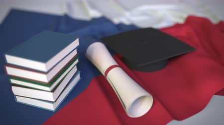 mortarboard : Graduation cap, books and diploma on the Czech flag. Higher education in the Czech Republic related conceptual 3D animation Stock Footage