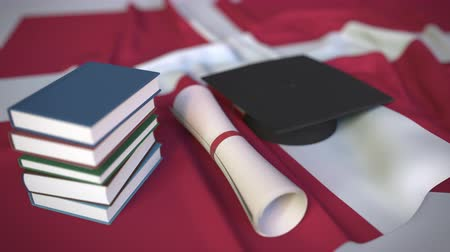 mortarboard : Graduation cap, books and diploma on the Danish flag. Higher education in Denmark related conceptual 3D animation