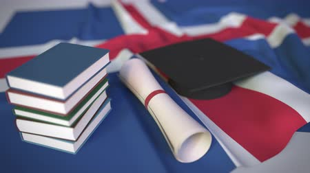 bakalář : Graduation cap, books and diploma on the Icelandic flag. Higher education in Iceland related conceptual 3D animation