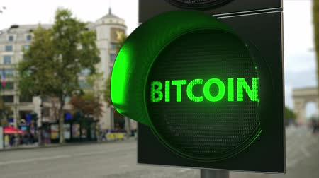 политика : Bitcoin word on green traffic light signal. Cryptocurrency related conceptual 3D animation