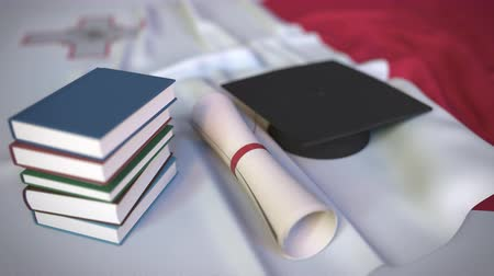 mortarboard : Graduation cap, books and diploma on the Maltese flag. Higher education in Malta related conceptual 3D animation
