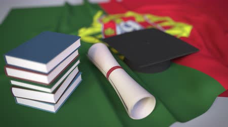 mortarboard : Graduation cap, books and diploma on the Portuguese flag. Higher education in Portugal related conceptual 3D animation