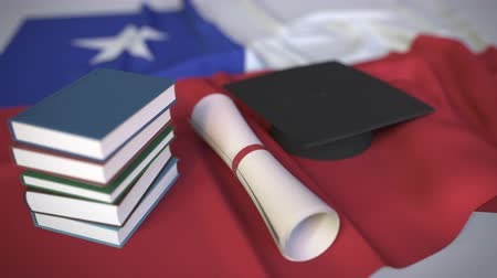 mortarboard : Graduation cap, books and diploma on the Chilean flag. Higher education in Chile related conceptual 3D animation