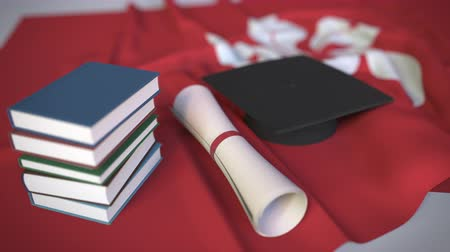 master's degree : Graduation cap, books and diploma on the flag. Higher education in Hong Kong related conceptual 3D animation