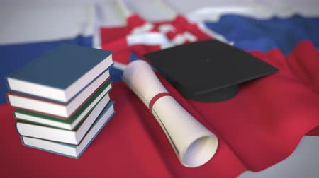 mortarboard : Graduation cap, books and diploma on the Slovak flag. Higher education in Slovakia related conceptual 3D animation