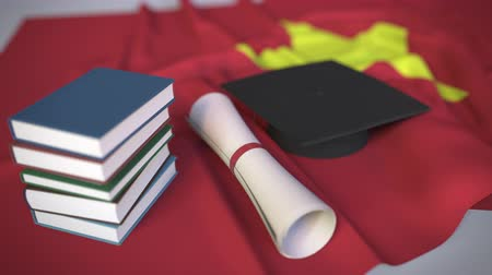 mortarboard : Graduation cap, books and diploma on the Vietnamese flag. Higher education in Vietnam related conceptual 3D animation