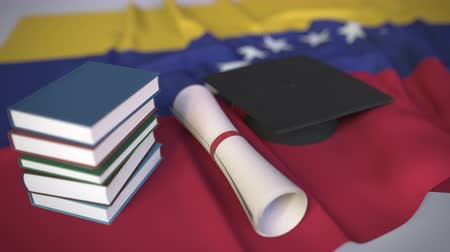 mortarboard : Graduation cap, books and diploma on the Venezuelan flag. Higher education in Venezuela related conceptual 3D animation