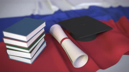 mais alto : Graduation cap, books and diploma on the Russian flag. Higher education in Russia related conceptual 3D animation