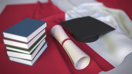 mortarboard : Graduation cap, books and diploma on the Peruvian flag. Higher education in Peru related conceptual 3D animation Stock Footage