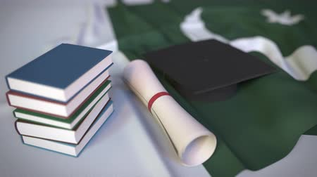 master's degree : Graduation cap, books and diploma on the Pakistani flag. Higher education in Pakistan related conceptual 3D animation