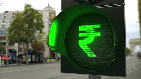 enable : Rupee sign on green traffic light signal. Forex related conceptual 3D animation
