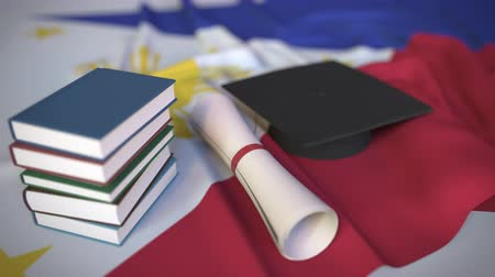 master's degree : Graduation cap, books and diploma on the flag. Higher education in the Philippines related conceptual 3D animation