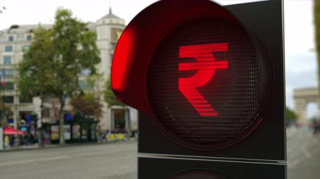 запрещенный : Rupee sign on red traffic light signal. Forex related conceptual 3D animation