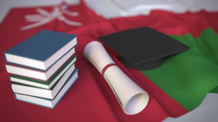 mortarboard : Graduation cap, books and diploma on the Omani flag. Higher education in Oman related conceptual 3D animation