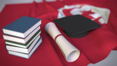 mais alto : Graduation cap, books and diploma on the Tunisian flag. Higher education in Tunisia related conceptual 3D animation