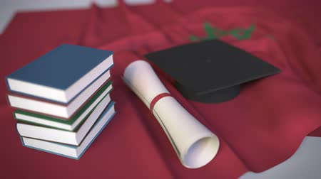 master's degree : Graduation cap, books and diploma on the Moroccan flag. Higher education in Morocco related conceptual 3D animation