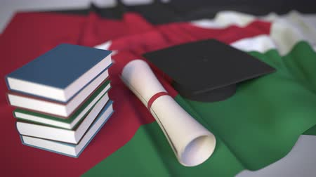 grãos : Graduation cap, books and diploma on the Jordanian flag. Higher education in Jordan related conceptual 3D animation Stock Footage