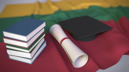 flag of lithuania : Graduation cap, books and diploma on the Lithuanian flag. Higher education in Lithuania related conceptual 3D animation