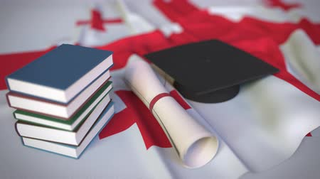 master's degree : Graduation cap, books and diploma on the Georgian flag. Higher education in Georgia related conceptual 3D animation