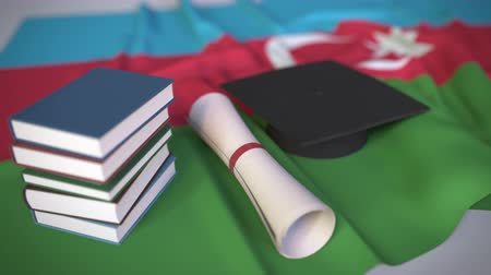 grãos : Graduation cap, books and diploma on the Azerbaijani flag. Higher education in Azerbaijan related conceptual 3D animation