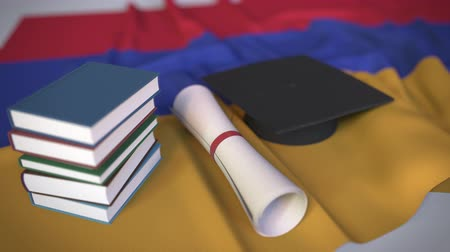 master's degree : Graduation cap, books and diploma on the Armenian flag. Higher education in Armenia related conceptual 3D animation