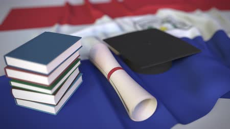 master's degree : Graduation cap, books and diploma on the Paraguayan flag. Higher education in Paraguay related conceptual 3D animation