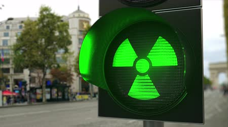 핵 : Radiation hazard symbol on green traffic light signal. Nuclear power related conceptual 3D animation