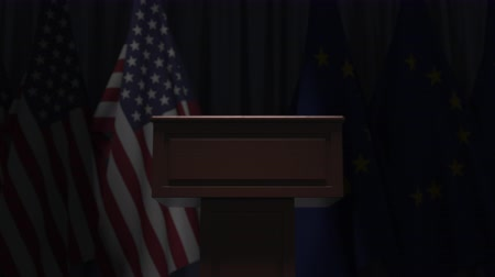 podyum : Flags of the USA and the EU and speaker podium tribune. Political event or negotiations related conceptual 3D animation Stok Video