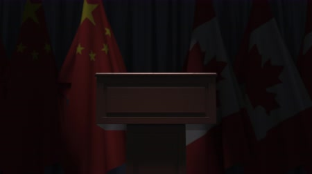 press conference : Flags of China and Canada and speaker podium tribune. Political event or negotiations related conceptual 3D animation Stock Footage