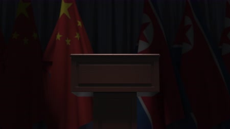 press conference : Flags of China and North Korea and speaker podium tribune. Political event or negotiations related conceptual 3D animation