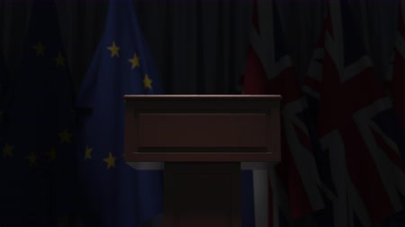 podyum : Flags of the EU and the United Kingdom and speaker podium tribune. Political event or negotiations related conceptual 3D animation