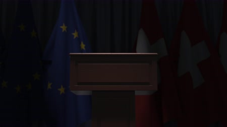 podyum : Flags of the EU and Switzerland and speaker podium tribune. Political event or negotiations related conceptual 3D animation