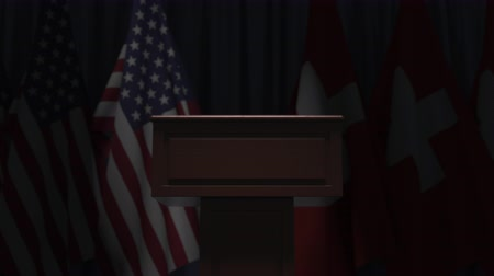 podyum : Flags of the USA and Switzerland and speaker podium tribune. Political event or negotiations related conceptual 3D animation