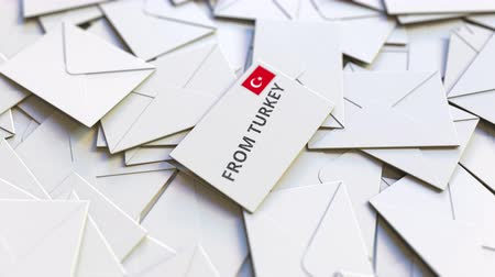 sello postal : Envelope with From Turkey stamp among other envelopes. International mail related conceptual 3D animation