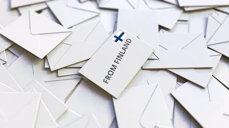 news letter : Letter with From Finland text on pile of other Letters. International mail related conceptual 3D animation