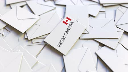 canadense : Letter with From Canada text on pile of other Letters. International mail related conceptual 3D animation Stock Footage