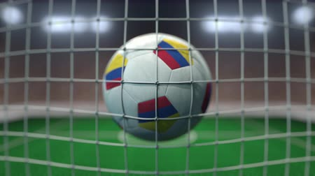 colômbia : Football with flags of Colombia hits goal net. Slow motion 3D animation