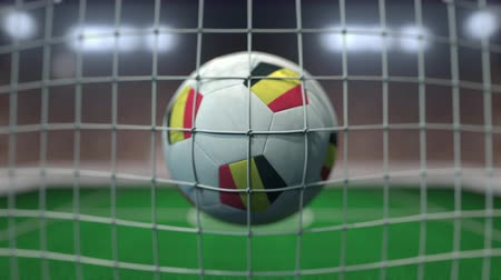 belga : Football with flags of Belgium hits goal net. Slow motion 3D animation