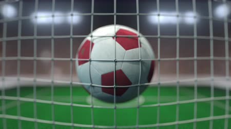 марокканский : Football with flags of Morocco in net against blurred stadium. Conceptual 3D animation Стоковые видеозаписи