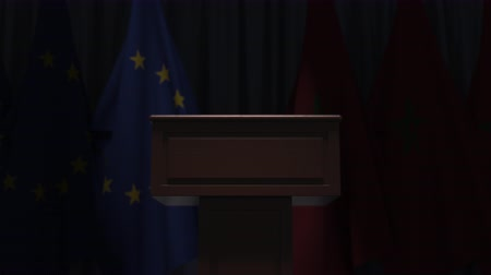 podyum : Flags of the EU and Morocco and speaker podium tribune. Political event or negotiations related conceptual 3D animation