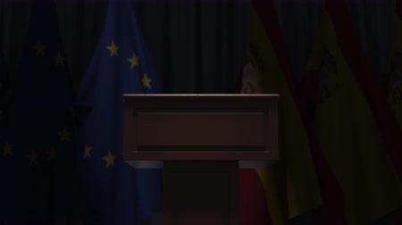 podyum : Flags of the EU and Spain and speaker podium tribune. Political event or negotiations related conceptual 3D animation
